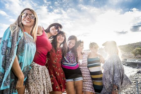 People friends group of young cheerful women smiling and having fun together  outdoor in summer holiday vacation leisure activity - caucasian females hugging and enjoy the beautiful day Stok Fotoğraf