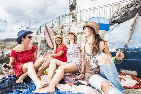 People in friendship outdoor leisure activity - group of beautiful cheerful women friends enjoy together the day on vacation - trendy fashion lifestyle for young ladies Stok Fotoğraf