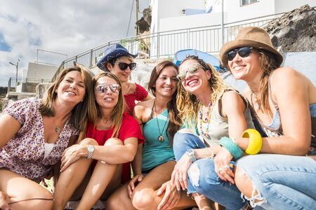 Group of cheerful and happy young women friends enjoy the day during summer vacation together in friendship - people have fun and laugh - beautiful ladies in a sunny day Stok Fotoğraf