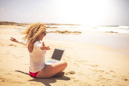 Joyful and happiness job related for young modern people working out of office frree in the world - successful beautiful woman with computer laptop connected at the beach with sea view