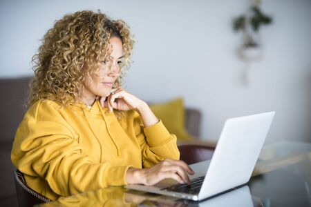 Smart work at home during coronavirus quarantine emergency concept - modern technology lifestyle of people with digital online job - woman with laptop computer