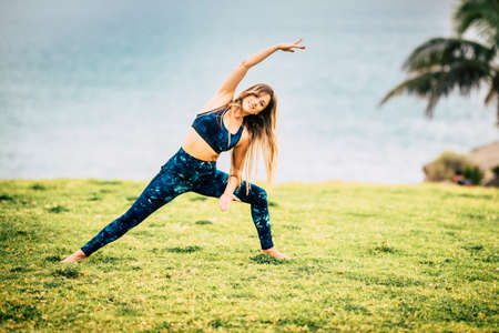 Active people lifestyle in outdoor park - beautiful caucasian adult young woman do fitness active exercise to stay healthy and beauty - diet and weight loss concept