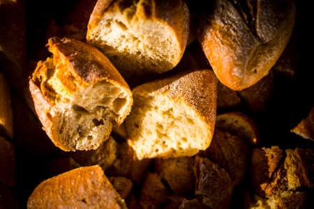 Vertical view of bread in dark background