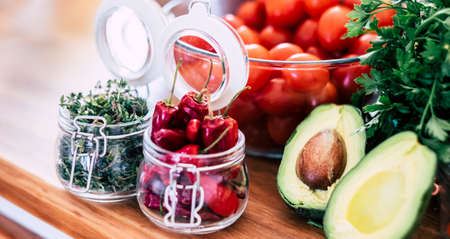 Variety of fruits and vegetables at home or kitchen restaurant in close sup image - concept of diet and vegetarian or vegan food nutrition healthy lifestyle - natural seasonal vitamin table ingredients Stockfoto