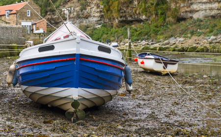 tide: Fishing boats at low tide Stock Photo