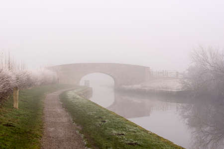 Canal on a freezing foggy day Reklamní fotografie