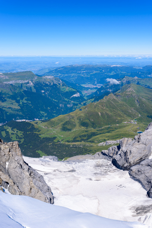 View from Jungfraujoch platform to Lauterbrunnen, Bernese Alps in Switzerland - travel destination in Europe Stock Photo