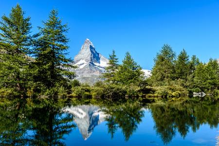 Grindjisee - beautiful lake with reflection of Matterhorn at Zermatt, Switzerland Stock Photo