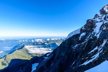 View from Jungfraujoch platform to Lauterbrunnen, Bernese Alps in Switzerland - travel destination in Europe Stock Photo