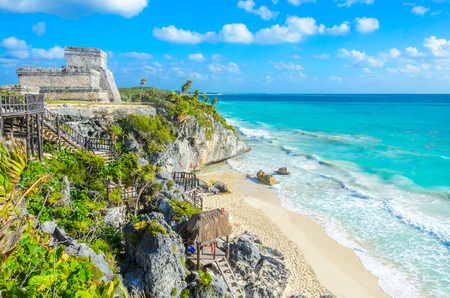 Mayan ruins of Tulum at tropical coast. El Castillo Temple at paradise beach. Mayan ruins of Tulum, Quintana Roo, Mexico.