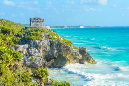 Mayan ruins of Tulum at tropical coast. God of Winds Temple at paradise beach. Mayan ruins of Tulum, Quintana Roo, Mexico. Stock Photo