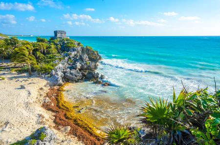 yucatan: Mayan ruins of Tulum at tropical coast. God of Winds Temple at paradise beach. Mayan ruins of Tulum, Quintana Roo, Mexico. Stock Photo