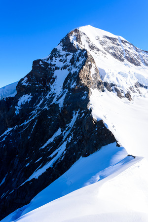 monch: Moench mountain - View of the mountain Moench in the Bernese Alps in Switzerland - travel destination in Europe