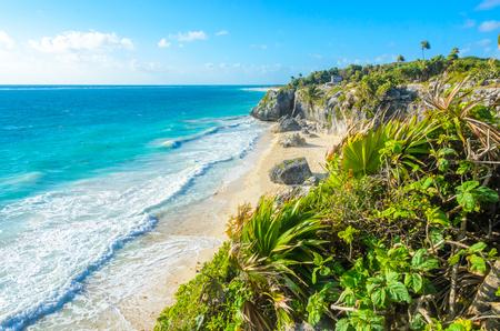 Paradise beach at mayan ruins of Tulum, Quintana Roo, Mexico. Mayan ruins of Tulum at tropical coast. Stock Photo