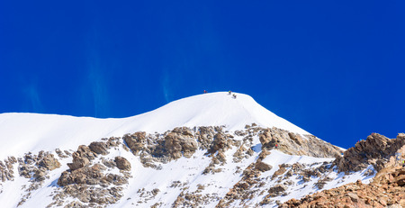 monch: Extrem Ice climbing on Moench mountain - View of the mountain Moench in the Bernese Alps in Switzerland - travel destination in Europe Stock Photo