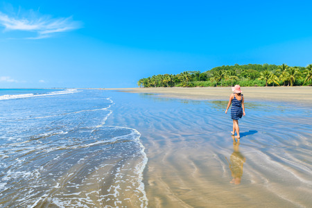 Girld walking in Marino Ballena National Park in Uvita - beautiful beaches and tropical forest at pacific coast of Costa Rica Stok Fotoğraf