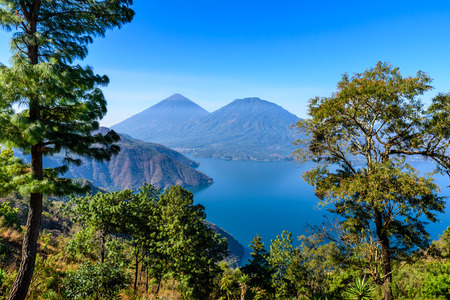 Panorama view of the lake Atitlan and volcanos  in the highlands of Guatemala Stock Photo - 83291854