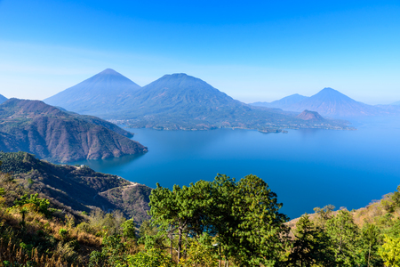 crater lake: Panorama view of the lake Atitlan and volcanos  in the highlands of Guatemala