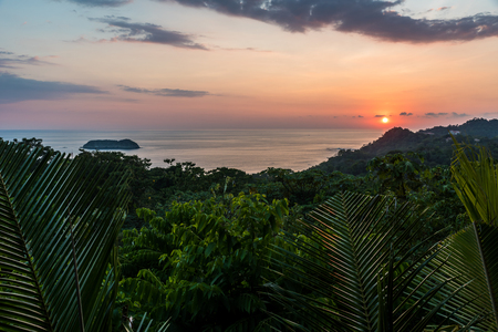 playa: Sunset at Manuel Antonio, Costa Rica - tropical pacific coast Stock Photo