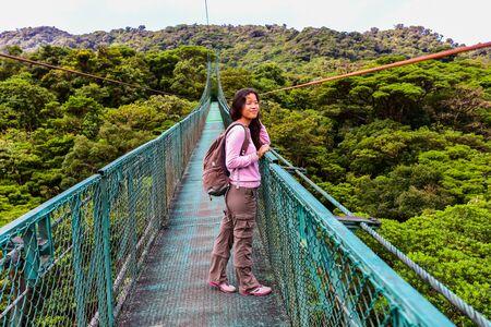Girl on hanging bridge in cloudforest - Monteverde, Costa Rica