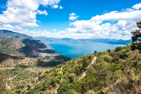 Viewpoint at lake Atitlan - view to the small villages San Marcos, Panajachel and San Marcos at the lake in the highlands of Guatemala Banco de Imagens