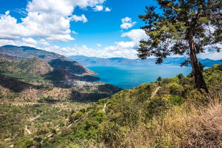 crater lake: Viewpoint at lake Atitlan - view to the small villages San Marcos, Panajachel and San Marcos at the lake in the highlands of Guatemala Stock Photo