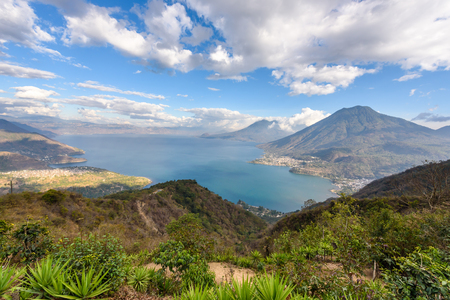 Panorama view to the lake Atitlan with volcanos - small villages San Pedro, San Marcos, San Juan and Panajachel at lake Atitlan in the highland of Guatemala