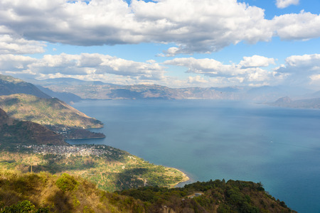 Viewpoint at lake Atitlan - view to the small villages San Marcos, Panajachel and San Marcos at the lake in the highlands of Guatemala Imagens