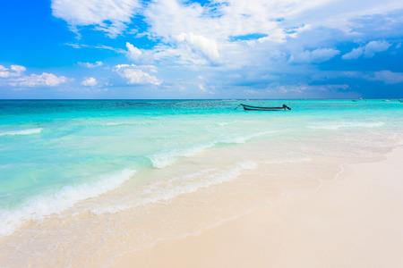 Xpu-Ha Beach - boat at beautiful caribbean coast of Mexico - Riviera Maya Imagens - 83480648