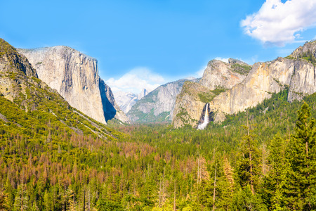 View of Yosemite Valley from Tunnel View point - view to Bridal veil falls, El Capitan and Half Dome - Yosemite National Park in California, USA