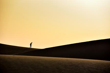 Men walking in the desert of gran canaria, spain