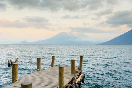 Pier at San Marcos La Laguna with beaufiful scenery of Lake Atitlan and volcanos - Guatemala