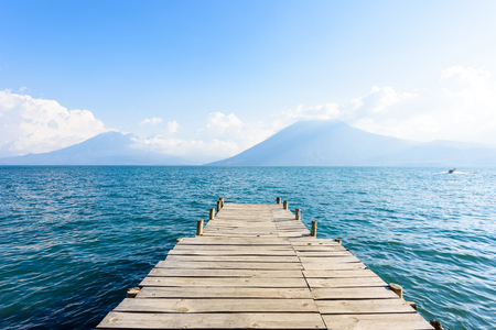 Pier at San Marcos La Laguna with beaufiful scenery of Lake Atitlan and volcanos - Guatemala