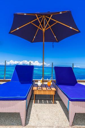 sunshade: Sunbed on tropical beach
