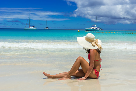 Girl relaxing at paradise beach in Seychelles, island Praslin - Anse Lazio