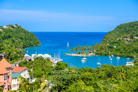 Marigot Bay, Saint Lucia, Caribbean. Tropical bay and beach in exotic and paradise landscape scenery. Marigot Bay is located on the west coast of the Caribbean island of St Lucia. Stockfoto