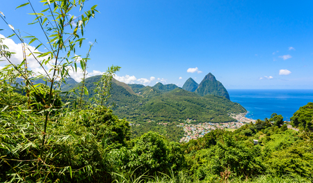 is green: Gros and Petit Pitons near village Soufriere on Caribbean island St Lucia - tropical and paradise landscape scenery on Saint Lucia Stock Photo