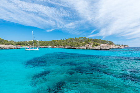 Sailing boats at Cala Mondrago - beautiful beach and coast of Mallorca Stok Fotoğraf