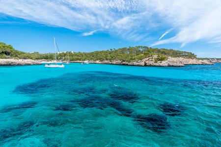 mallorca: Sailing boats at Cala Mondrago - beautiful beach and coast of Mallorca Stock Photo