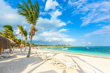 Relaxing on sun lounger at Akumal Beach - Riviera Maya - paradise beaches at Cancun, Quintana Roo, Mexico - Caribbean coast - tropical destination for vacation 新闻类图片