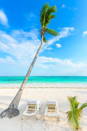 Relaxing on sun lounger at Akumal Beach - Riviera Maya - paradise beaches at Cancun, Quintana Roo, Mexico - Caribbean coast - tropical destination for vacation Stock Photo