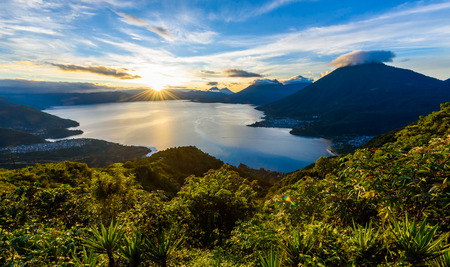Sunrise in the morning at lake Atitlan, Guatemala - amazing panorama view to the volcanos San Pedro, Toliman and Atitlan Stock Photo