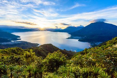Sunrise in the morning at lake Atitlan, Guatemala - amazing panorama view to the volcanos San Pedro, Toliman and Atitlan Standard-Bild