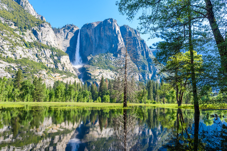 Yosemite National Park - Reflection in Merced River of Yosemite waterfalls and beautiful mountain landscape, California, USA