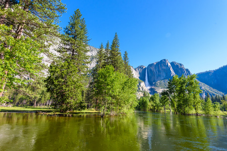Yosemite National Park - Reflection in Merced River of Yosemite waterfalls and beautiful mountain landscape, California, USA Reklamní fotografie