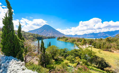 Beautiful bay of Lake Atitlan with view to Volcano San Pedro  in highlands of Guatemala, Central America