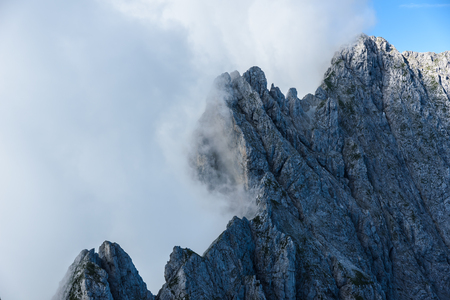 Mountains in clouds at Ellmauer Halt, Wilder Kaiser mountains of Austria - close to Gruttenhuette, Going, Tyrol, Austria - Hiking in the Alps of Europe Stock Photo
