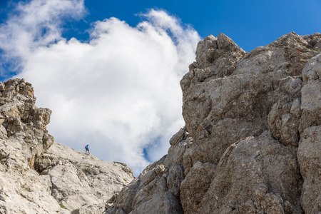 Hiker at Ellmauer Halt, Wilder Kaiser mountains of Austria - close to Gruttenhuette, Going, Tyrol, Austria - Hiking in the Alps of Europe