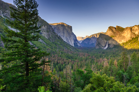 View of Yosemite Valley from Tunnel View point at sunset - view to Bridal veil falls, El Capitan and Half Dome - Yosemite National Park in California, USA Stock Photo