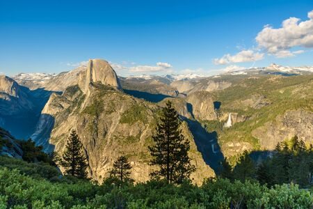 View of Half Dome, Yosemite Valley, Vernal and Nevada Falls from the Glacier Point in the Yosemite National Park, California, USA Stock Photo